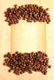 Coffee beans with old paper Royalty Free Stock Photos
