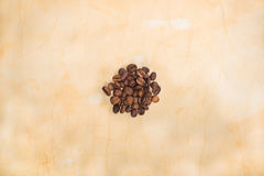 Coffee beans on old paper Royalty Free Stock Photos