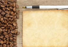 Coffee beans and old paper texture Royalty Free Stock Photos