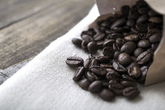 Coffee beans on old table. Stock Photography
