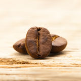 Coffee beans on old table - close up shot Stock Image