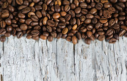 Coffee beans on the old wood Stock Photos