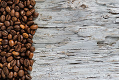 Coffee beans on the old wood background Stock Image