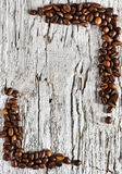 Coffee beans on the old wood background Stock Photos