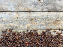 Coffee beans on old wood Stock Image