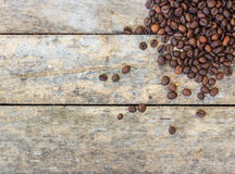 Coffee beans on old wood Royalty Free Stock Photos