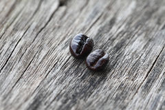 Coffee beans on the old wood texture background Royalty Free Stock Photo