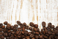 Coffee beans. On a old wooden background stock photography