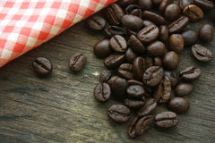 Coffee beans on an old wooden background Stock Photos