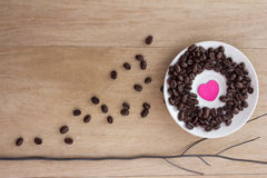 Coffee beans on old wooden background Stock Photo