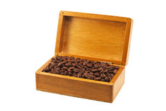 Coffee beans in the old wooden box isolated Stock Photography
