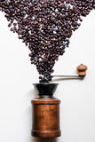 Coffee beans and retro wooden grinder on white background royalty free stock images