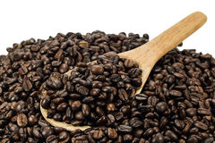 Coffee beans in an old wooden scoop Stock Image