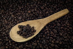 Coffee beans in an old wooden scoop Royalty Free Stock Photo