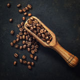 Coffee beans and an old wooden scoop Royalty Free Stock Photography