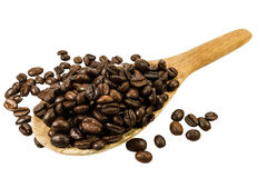 Coffee beans in an old wooden scoop on the white background Royalty Free Stock Photos