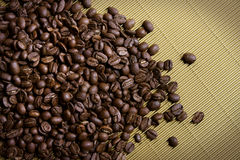 Coffee Beans On Gold Stock Image