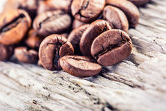 Free Coffee Beans  On Grunge Wooden Background. Stock Photos - 45933563