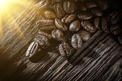 Coffee Beans On Vintage Wooden Board Stock Images