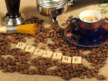 Coffee beans, one ornate cup, tamper and group handle with the letters offline on a hessian background. Melbourne 2017 stock photos