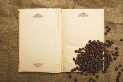 Coffee beans and open book Stock Image