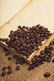 Coffee beans and open book Royalty Free Stock Photos