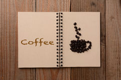 Coffee Beans on Open Notebook Royalty Free Stock Photography