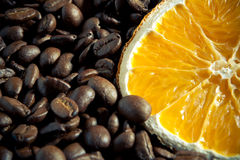 Coffee beans with orange. On yuta material close-up Royalty Free Stock Photography