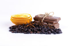 Coffee beans, orange lobules, chocolate and spices Royalty Free Stock Images