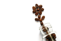 Coffee beans out of a glass bottle Royalty Free Stock Photos