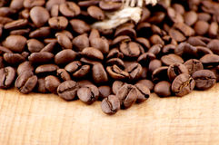 Coffee Beans. Over Wood Background Stock Photo