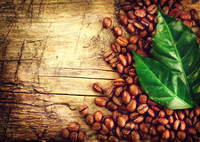 Coffee beans over wood background Royalty Free Stock Images