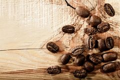 Coffee beans over wooden desk Royalty Free Stock Image