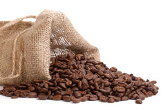 Coffee beans overflowing Royalty Free Stock Images