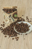 Coffee beans in the package boxes Stock Image