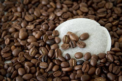 Coffee beans and pad Royalty Free Stock Photos