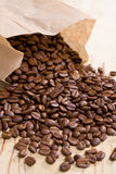 Coffee beans in paper bag Stock Photography