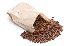 Coffee beans in paper bag Stock Images
