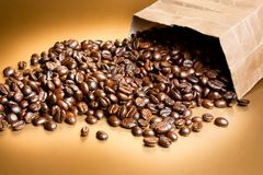 Coffee beans in a paper bag Royalty Free Stock Images