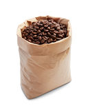 Coffee beans. In paper bag isolated on white royalty free stock image