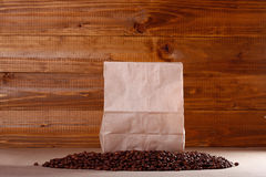 Coffee beans and paper bag Royalty Free Stock Images