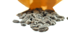 Coffee beans. In paper bag on white background Stock Photos