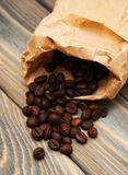 Coffee beans in paper bag Royalty Free Stock Photography