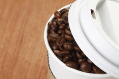 Coffee Beans in Paper Cup Royalty Free Stock Images