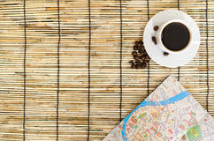 Coffee beans with paper map on mat royalty free stock images