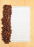 Coffee beans with paper for notes Royalty Free Stock Photography