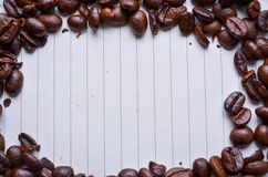 Coffee beans on paper for notes Stock Image