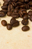 Coffee beans on paper Stock Photography