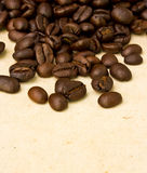 Coffee beans on paper Royalty Free Stock Photography