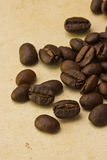Coffee beans on paper Stock Images